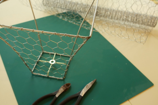 Remake old lampshade to fabulous chicken wire basket i laid the frame on its side on top of the chicken wire to use as a guide and clipped around it using wire cutters using needle nose pliers my husband greentooth Choice Image