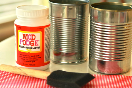 Supplies needed to make can phones - 2 recycled tin cans, gloss Mod Podge, foam paint brush and decorative paper.