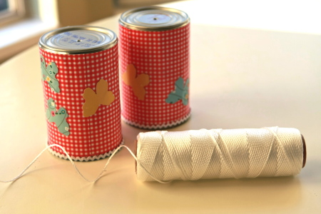 Decorated cans with holes punched and string for the phone line.
